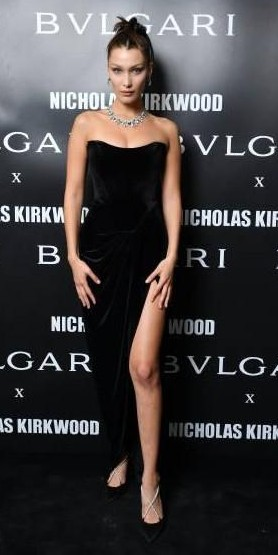Yay or Nay? Bella Hadid attends a party celebrating 'Serpenti Forever' By Nicholas Kirkwood wearing a velvet strapless dress during the Milan Fashion week - SeenIt