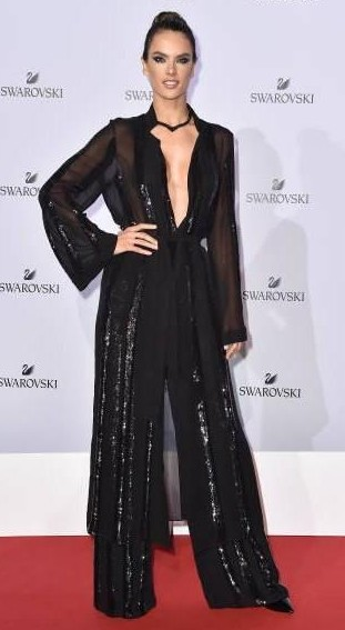 Yay or Nay? Alessandra Ambrosio wearing a black sheer jumpsuit attends Swarovski Crystal Wonderland Party during the Milan fashion week - SeenIt