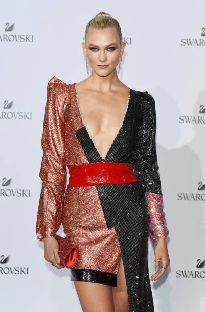 Yay or Nay? Karlie Kloss attends Swarovski Crystal Wonderland Party wearing a plunge neck shimmer dress during the Milan fashion week - SeenIt