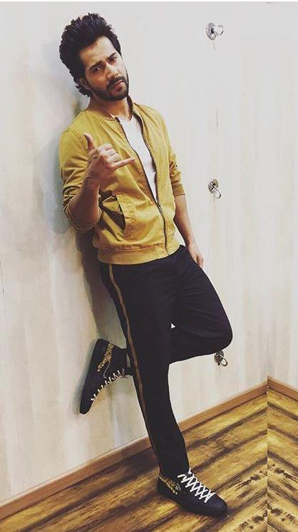 Looking for a similar yellow jacket online like Varun Dhawan is seen wearing while promoting his upcoming movie Judwaa2 - SeenIt