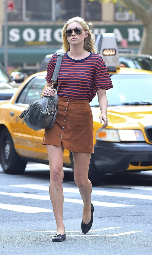 Help me find the red blue stripes top with brown button down skirt that Elsa Hosk is wearing - SeenIt