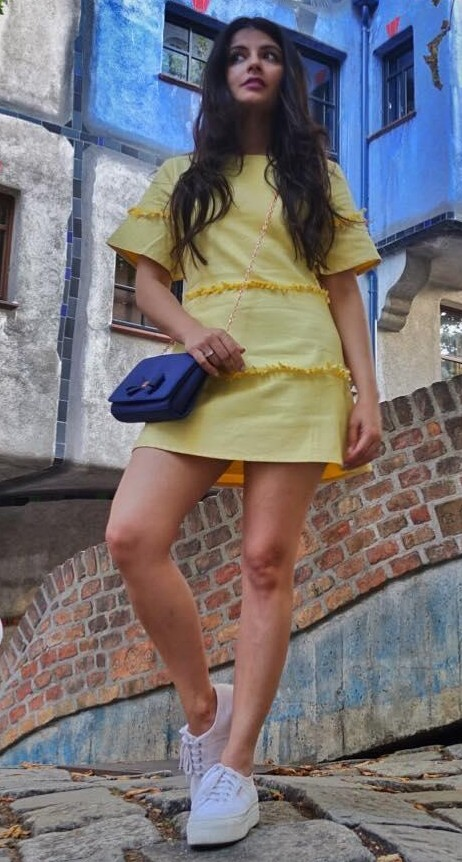 Help me find this yellow shift dress and white sneakers that Natontherocks is wearing. - SeenIt