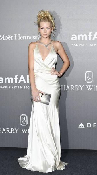Yay or Nay? Lottie Moss wearing a silver satin gown attends amfAR Gala Milano during the Milan fashion week - SeenIt