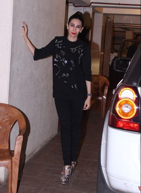 Looking for a similar black embellished top and jeans that Karisma Kapoor is wearing at Kareena Kapoor