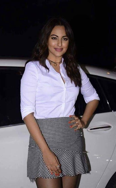 Help me find this white shirt with black checkered ruffles skirt that Sonakshi Sinha is wearing - SeenIt