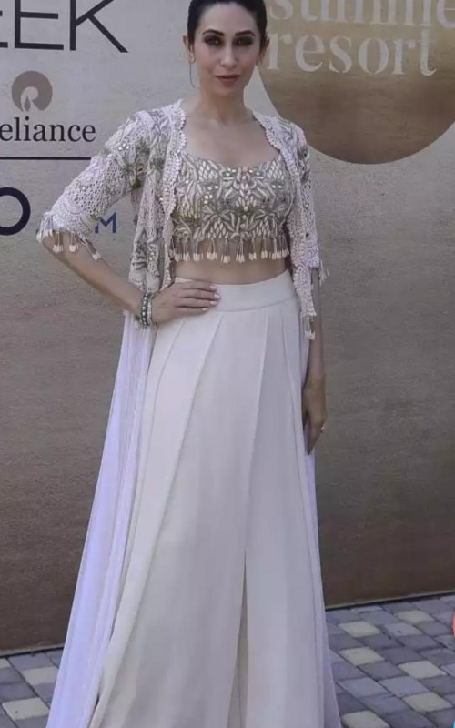 I am looking for similar embroidered top with sequins and tassels like the one which Karishma Kapoor is wearing - SeenIt