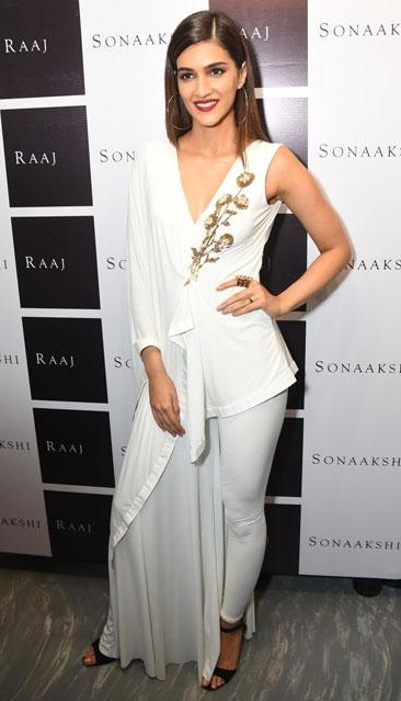 Kriti Sanon's white embellished jumpsuit is what I am looking for. - SeenIt