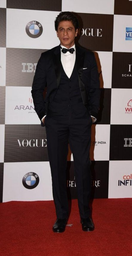 Yay or Nay? Shahrukh Khan wearing a classic black three piece tuxedo at the Vogue Women of the Year awards last night - SeenIt