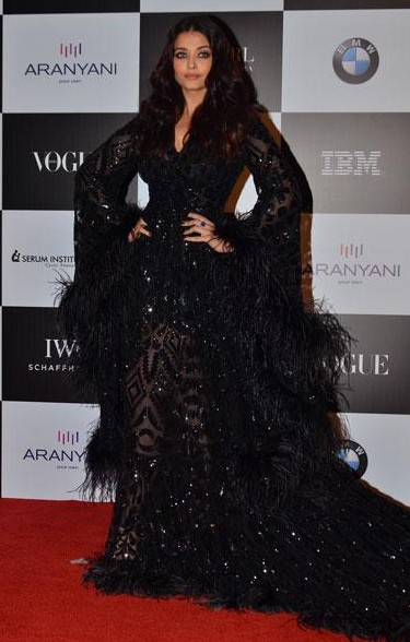 Yay or Nay? Aishwarya Rai Bachchan wearing a black embellished feather trail gown at the Vogue Women of the Year awards last night - SeenIt