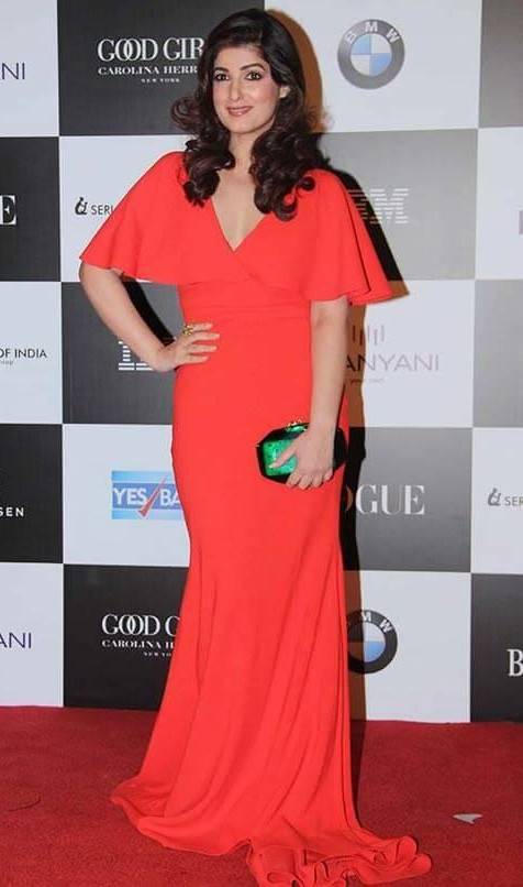 Yay or Nay? Twinkle Khanna wearing a red v neck gown at the Vogue Women of the Year awards last night - SeenIt