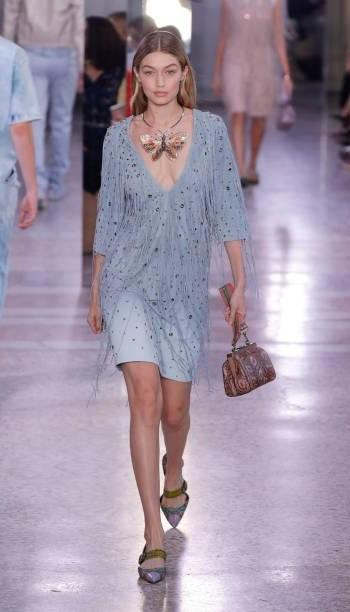 Yay or Nay? Gigi Hadid wearing a blue v neck dress walks the runway at the Bottega Veneta show during Milan Fashion Week - SeenIt
