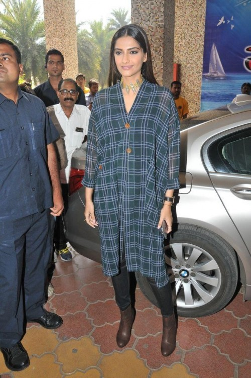 Want the green and blue checked dress and the black jeans which Sonam Kapoor is wearing - SeenIt