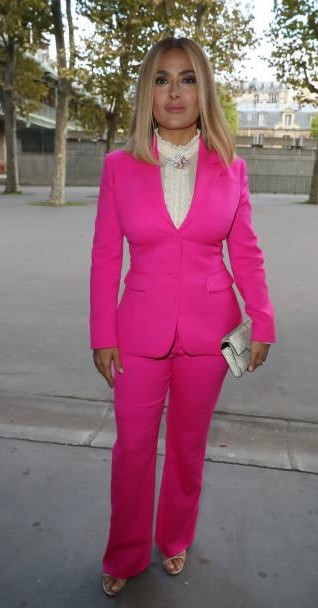 Yay or Nay? Salma Hayek wearing a pink pant suit attends the Altuzarra show during the Paris Fashion Week - SeenIt