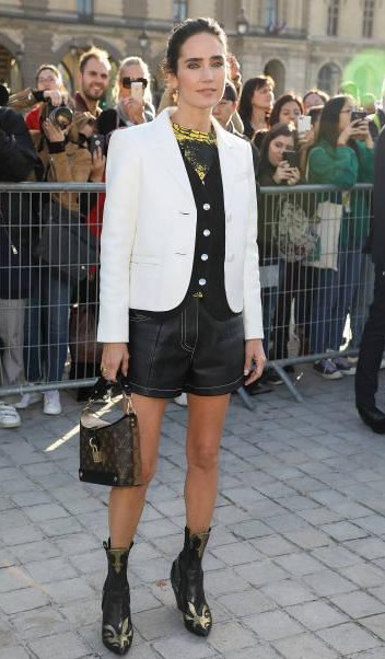 Yay or Nay? Jennifer Connelly attends the Louis Vuitton show during the Paris Fashion Week - SeenIt