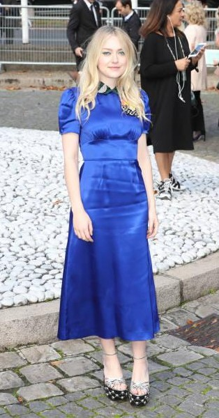 Yay or Nay? Dakota Fanning attends the Miu Miu show during the Paris Fashion Week - SeenIt