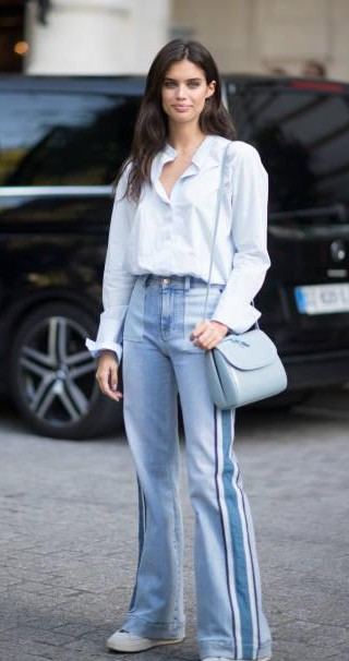 Yay or Nay? Sara Sampaio wearing a pair of boot leg jeans and shirt as seen in the streets of Paris during the Paris Fashion Week - SeenIt