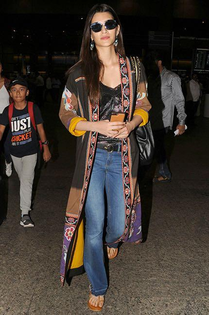 Looking for a similar satin black top and boot leg pants like Kriti Sanon is wearing at the airport - SeenIt
