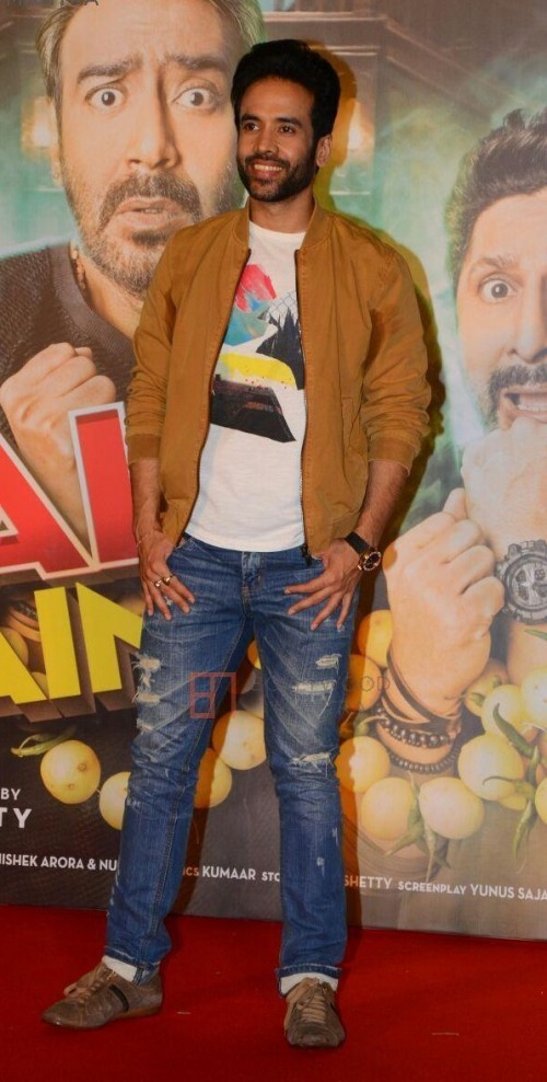 Help me find a similar outfit like Tusshar kapoor is wearing , the jeans , white tee and mustard bomber jacket at the promotions of Golmaal Again - SeenIt