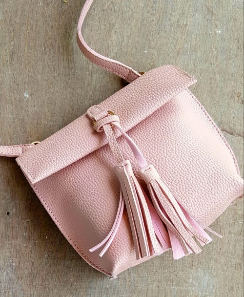 Want this pink double tassel sling bag - SeenIt