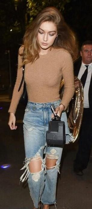 Help me find this ripped jeans with nude bodysuit! - SeenIt