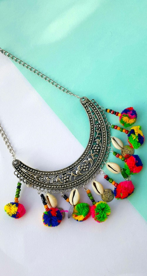 Looking for this pompom necklace - SeenIt