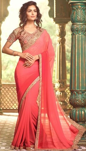 I'm looking for a similar peach georgette saree with a gold border - SeenIt