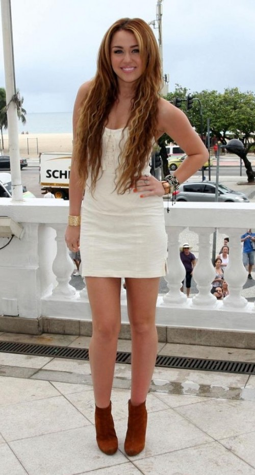 Need this similar white bodycon dress with brown boots as Miley Cyrus is wearing - SeenIt