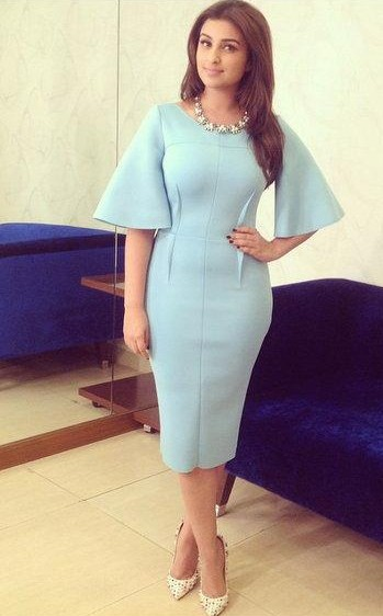 Want the blue bell-sleeve bodycon midi dress and white printed stilettos which Parineeti Chopra is wearing - SeenIt