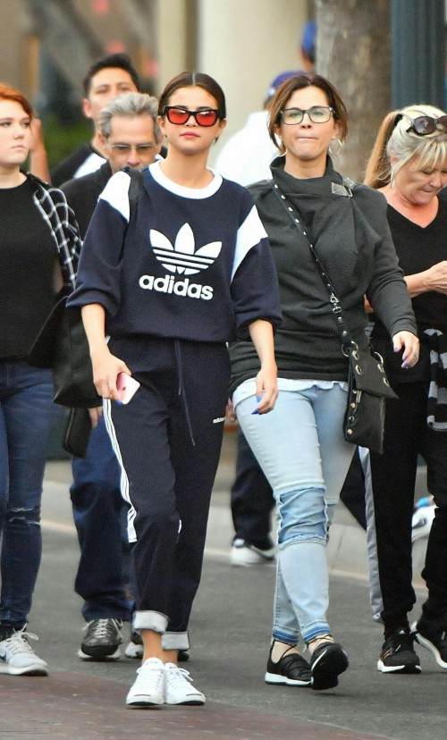 Want Selena's whole outfit , the adidas originals sweatshirt and joggers attire - SeenIt