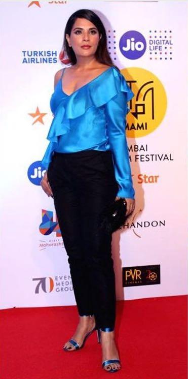 Yay or Nay? Richa Chadda wearing a satin blue ruffle one shoulder top with black pants at the opening ceremony of Mumbai film festival 2017 - SeenIt