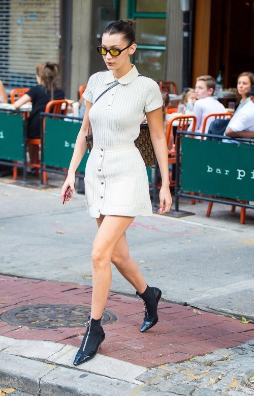 Looking for a white polo shirt, white miniskirt and the black boots similar to the ones which Bella Hadid is wearing - SeenIt
