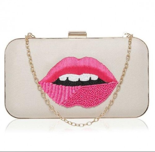 looking for the same lip embellished clutch - SeenIt