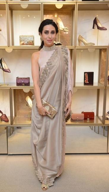 Need this silver saree that Karisma Kapoor is wearing - SeenIt