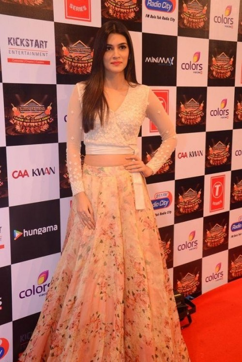 Want a similar white lace blouse and a pink floral skirt like the one which Kriti Sanon is wearing - SeenIt