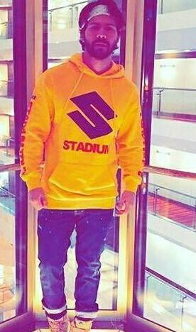 Want the printed yellow hoodie which Varun Dhawan is wearing for Judwaa 2 promotions - SeenIt