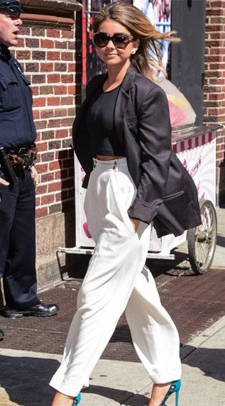 Help me find similar black crop top, blazer and white pants that Sarah Hyland is wearing - SeenIt