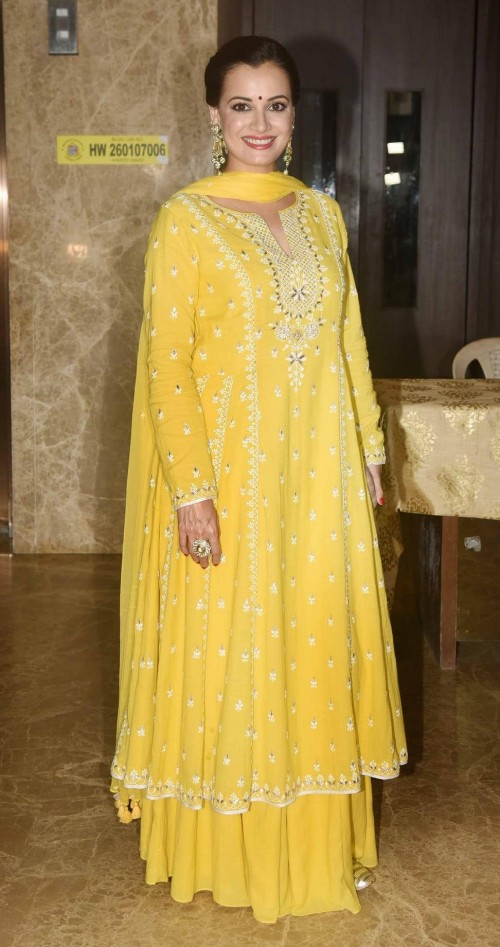 Yay or Nay? Dia Mirza wearing a yellow ethnic suit with skirt at the Ramesh Taurani diwali party recently - SeenIt