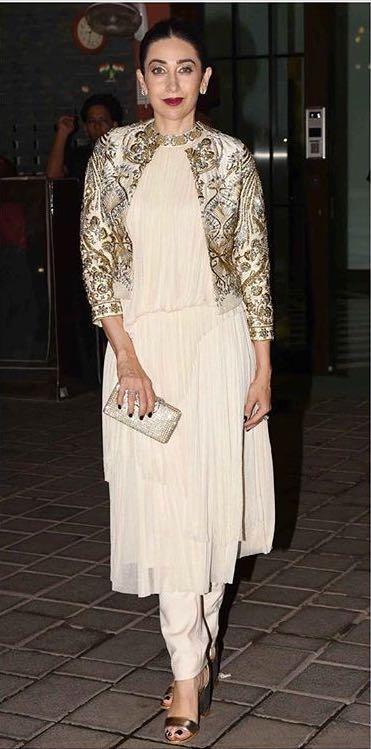 Yay or Nay? Karisma Kapoor wearing a white shrug indonwestern attire at Arpita Khan's diwali party recently - SeenIt