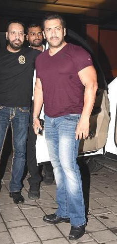 Yay or Nay? Salman Khan wearing a wine colored v neck tee and jeans at Arpita Khan's diwali party recently - SeenIt