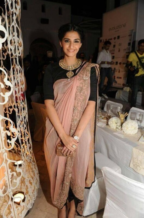 I am looking for this similar peach saree which Sonam Kapoor is wearing  please help me - SeenIt