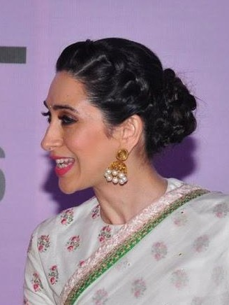 Looking for the gold with pearls jhumka that Karisma Kapoor is wearing - SeenIt