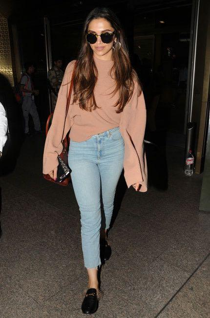 Looking for a similar oversized sweatshirt and blue skinny jeans like Deepika Padukone is wearing at the Mumbai airport - SeenIt