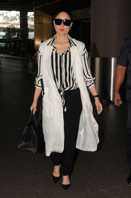 Help me find a similar striped top and black jeans , also the sleeveless white long jacket like Kareena Kapoor is wearing at the Mumbai airport - SeenIt