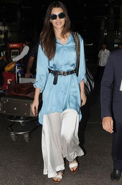 Can you help me find a similar white pair of satin palazzos like Kriti Sanon is wearing - SeenIt