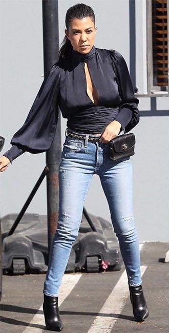 Looking for a similar pair of skinny light blue denims and black boots like Kourtney Kardashian is wearing in Los Angeles - SeenIt