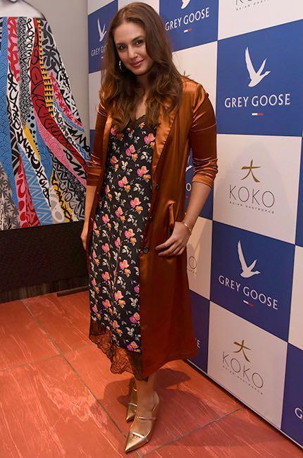 Help me find a similar brown satin coat and floral midi dress like Huma Qureshi is wearing at Koko in Mumbai - SeenIt