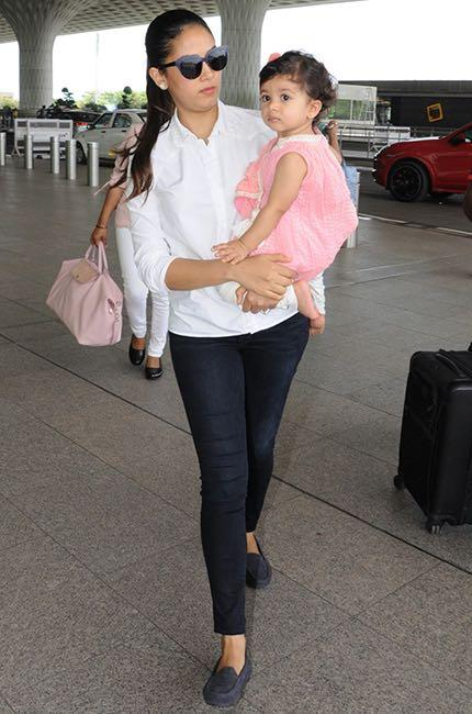 Need a similar white shirt and blue denims like Mira Rajput is seen wearing at the airport recently - SeenIt
