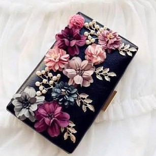 Looking for the same floral clutch - SeenIt