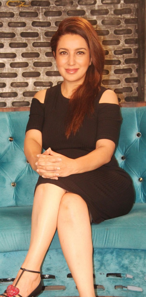 Looking for this black cold shoulder dress that Tisca Chopra is wearing - SeenIt