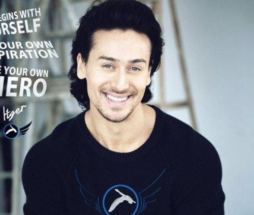 Want this tshirt which has this symbol on shirt with blue or black coloured which Tiger Shroff is wearing - SeenIt